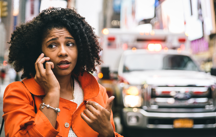 woman calling 911 in New york city. been in an accident